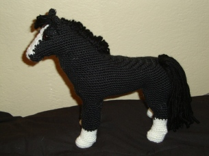 Realistic black horse side view